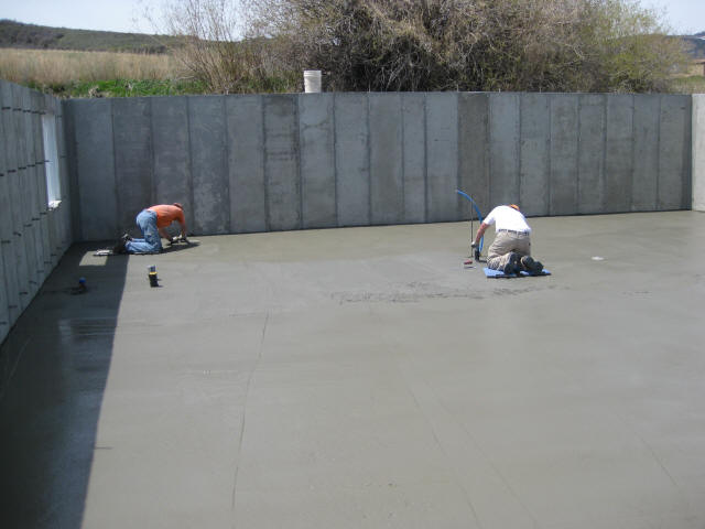 The Final Floating And Troweling Is Done By Hand Before The Concrete Slab  Sets Up Too Hard To Work.