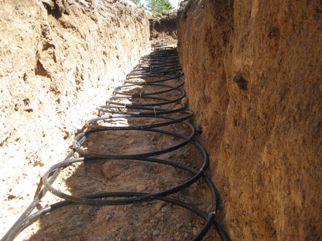 Geo pipe laid in trench. Geothermal ...