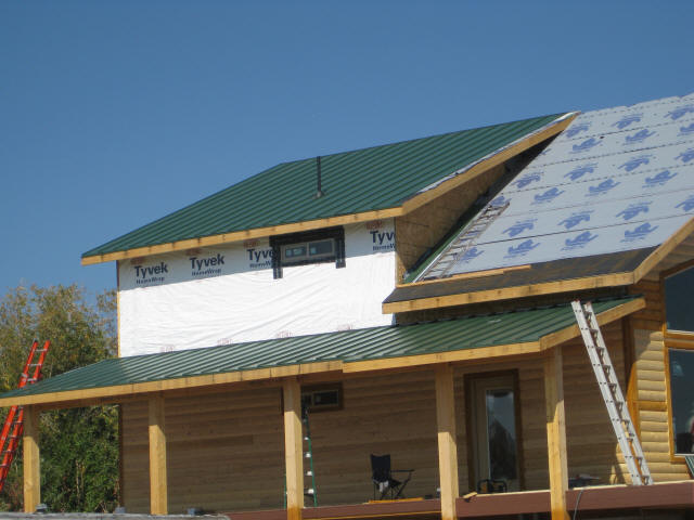 Installing standing seam metal roof Cabins with metal roofs